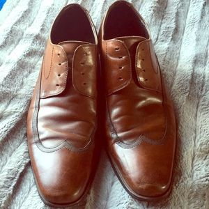 Worn Kenneth Cole Reaction brown dress shoes